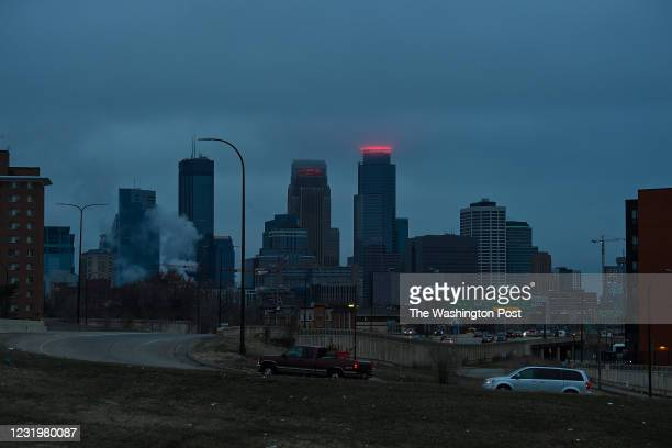 Vehicles drive along Hiawatha Avenue as the clouds hover above the skyline on March 26, 2021 in Minneapolis, Minnesota. Opening statements in the...