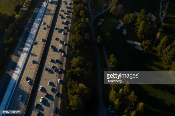 Vehicles drive along the 280 freeway in this aerial photograph taken over Menlo Park, California, U.S., on Wednesday, Feb. 26, 2020. Threats to...