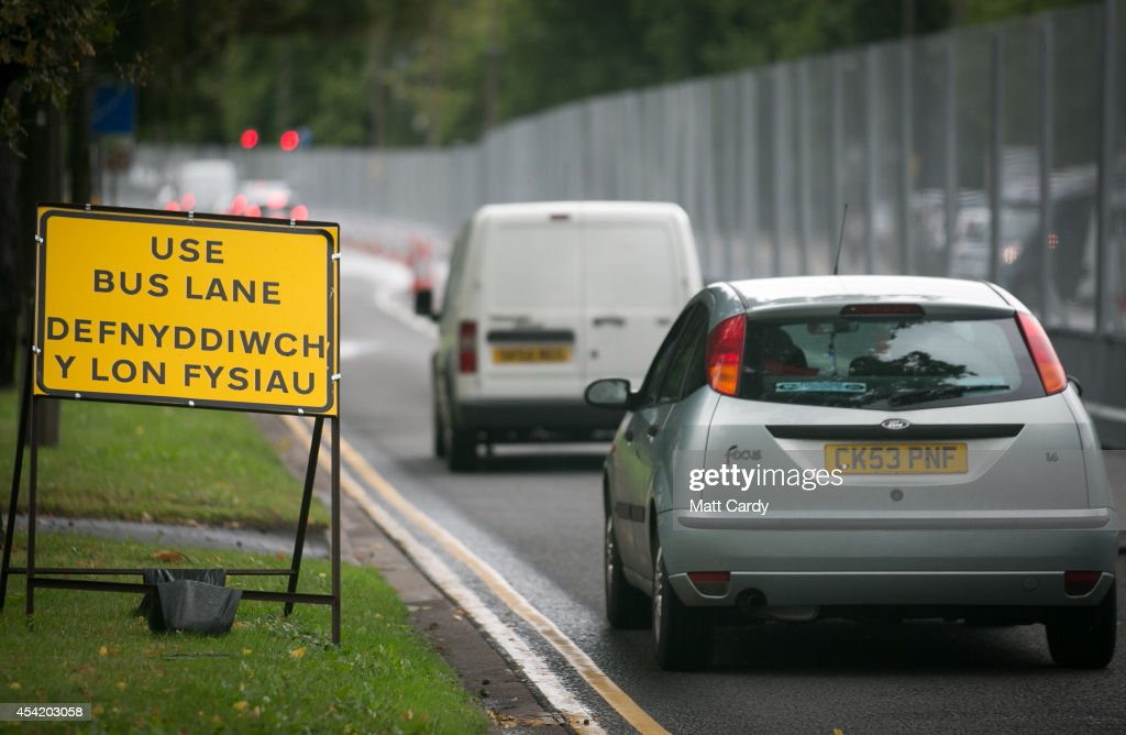Vehicles drive alongside the security fence that has been erected around the Royal Welsh College of Music and Drama ahead of the Nato Summit 2014 that is being held in South Wales next week on August 26, 2014 in Cardiff, Wales. The barriers have been erected in the Welsh capital as a security measure as preparations for the international conference continue at the Celtic Manor Resort in Newport.