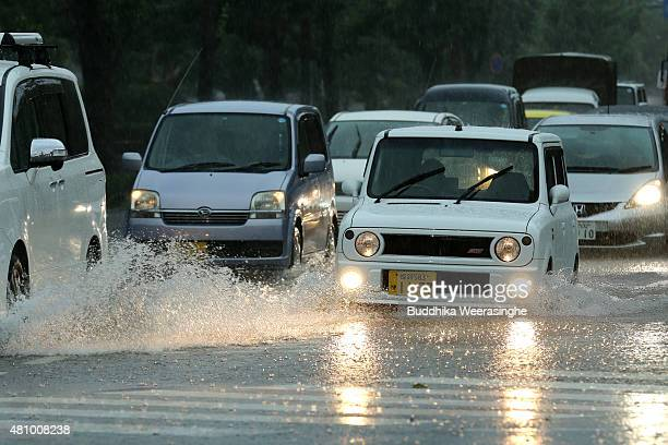 Vehicles drive among the flooded road during the heavy rain and wind delivered by typhoon Nangka on July 17, 2015 in Himeji, Japan. As Typhoon Nangka...