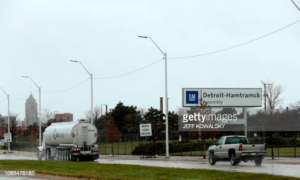 Vehicles drive by the General Motors DetroitHamtramck Assembly as they announced the closing of multiple facilities including this one on November 26...
