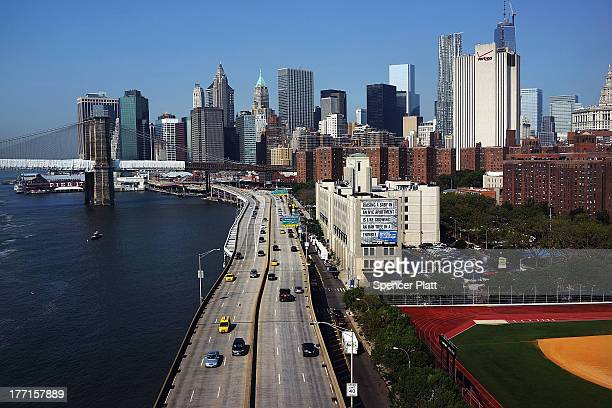 Vehicles drive down the Franklin D Roosevelt East River Drive or FDR Drive as seen from the Manhattan Bridge on August 21 2013 in New York City The...