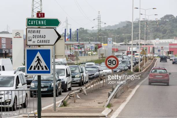 Vehicles drive in Cayenne in French Guiana on April 21 following talks to put an end to general strike over living conditions. / AFP PHOTO / jody...