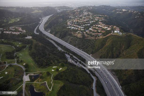 Vehicles drive in light traffic along the 405 freeway, through the Sepulveda Pass, in this aerial photograph taken above Los Angeles, California,...