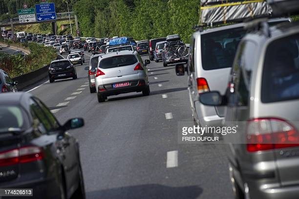 Vehicles drive in traffic jams during holiday departures on July 27 2013 on the A10 highway in Massy southwest of Paris The French traffic...
