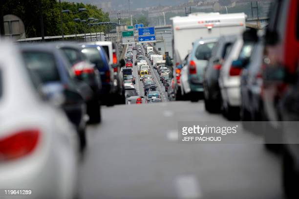 Vehicles drive in traffic jams on the A7 motorway on July 2011 near Vienne southeastern France 400 kmlongtraffic jams were reported at midday in...