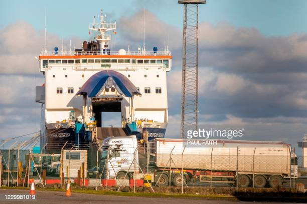 Vehicles drive off a P&O ferry at the Port of Larne in Co Antrim, Northern Ireland on December 6, 2020. - The port, which handles travel and freight...
