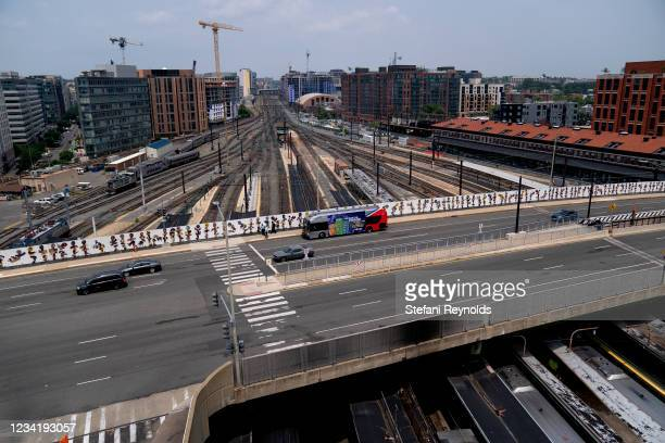 Vehicles drive on a bridge over train tracks near Union Station on July 25, 2021 in Washington, DC. Lawmakers are working to finalize an...