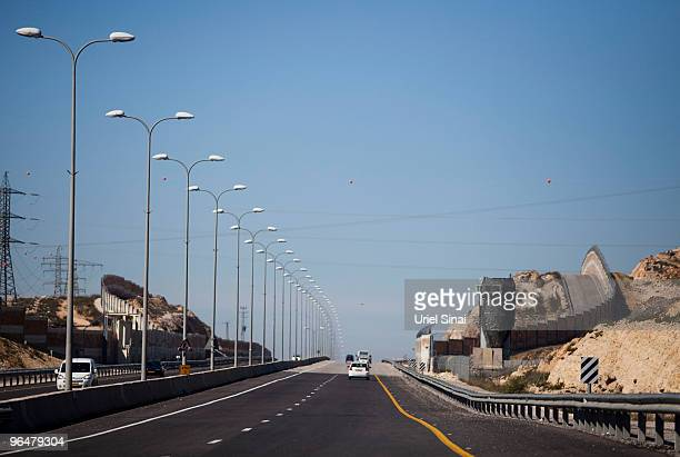 Vehicles drive on route 443 a main road on which Palestinian traffic is forbidden linking central Israel with Jerusalem as Israel's separation...