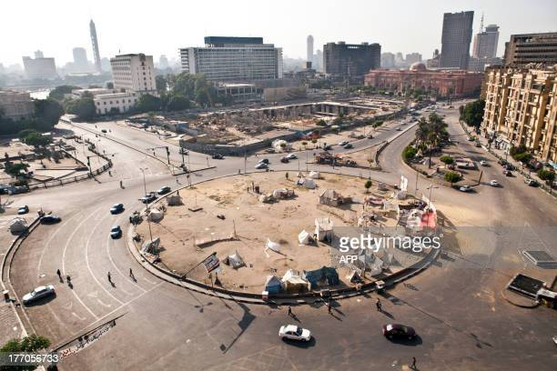 Vehicles drive on Tahrir Square after it has been partially reopened to traffic as tents of opponents to Egyptian deposed president Mohammed Morsi...