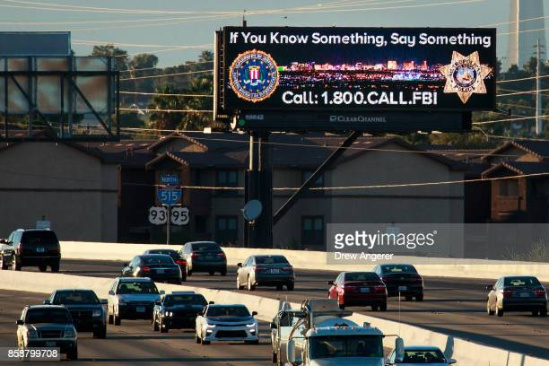 Vehicles drive past a billboard featuring a Federal Bureau of Investigation tip line phone number on Interstate 515 October 7 2017 in Las Vegas...