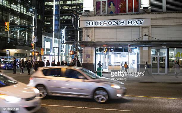 Vehicles drive past a Hudson's Bay Co store in downtown Vancouver British Columbia Canada on Wednesday Jan 11 2017 Hudsons Bay Co the Canadian...