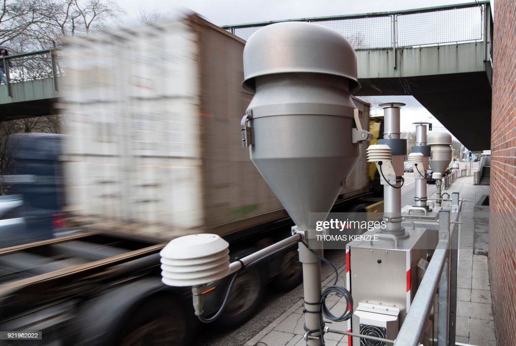 Vehicles drive past a sensor measuring particulate pollution on a busy road on February 1, 2018 at a traffic junction of the Neckartor roadway, a Stuttgart neighbourhood which is a hotspot for air pollution. A court is to rule on February 21, 2018 on whether cities in Germany can ban certain diesel cars to reduce air pollution in their most contaminated areas, a decision that could have far-reaching consequences for transport policy and for the vital industry. /
