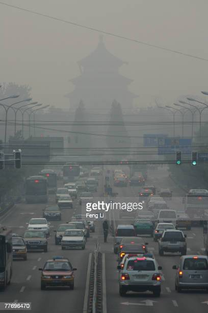 Vehicles drive past the Temple of Heaven on November 5 2007 In Beijing China The 2008 Olympics host city will introduce tougher car emission...