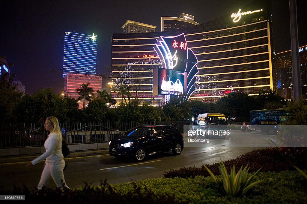 Vehicles drive past the Wynn Macau casino resort, operated by Wynn Resorts Ltd., in Macau, China, on Wednesday, Feb. 6, 2013. Casino industry revenue in the gambling hub climbed 14 percent to a record 304 billion patacas ($38 billion) last year. Photographer: Lam Yik Fei/Bloomberg via Getty Images