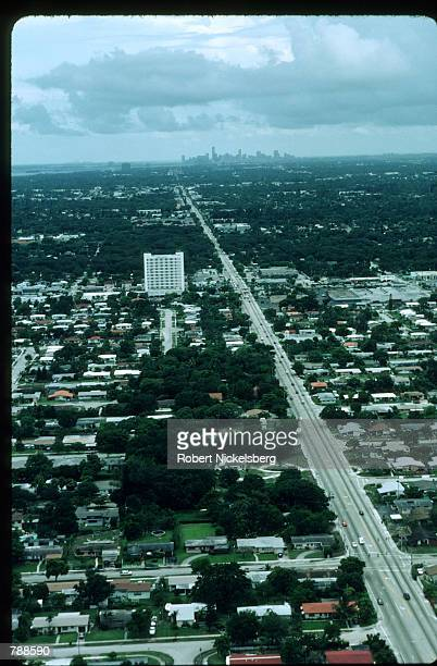 Vehicles drive south toward Miami June 15 1999 near the Everglades National Park Fl The modified water project which would protect the Miccosukee...