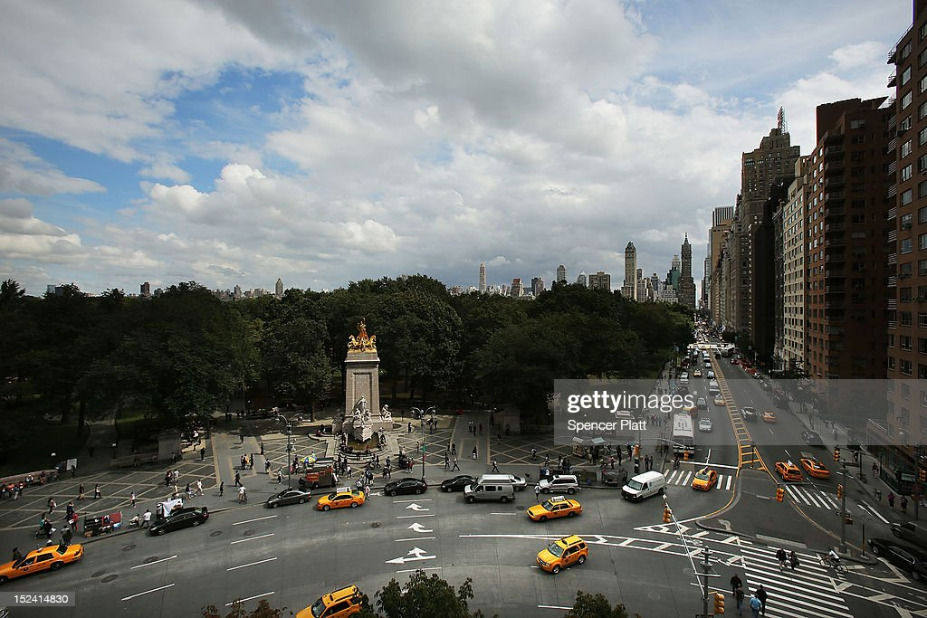 Vehicles drive through Columbus Circle as seen from the 810-square-foot 'living room' art installation by Japanese artist Tatzu Nishi that features the 13-foot statue of Christopher Columbus on September 20, 2012 in New York City. Viewed as a piece of conceptual art, 'Living Room', sits 70-feet above ground level and is only accessible via a scaffold-encased staircase that has been temporarily built around the Columbus Monument in Columbus Circle. Beginning September 20, up to 25 people at a time can enter the living room and view the 1892 marble figure of the Italian explorer.