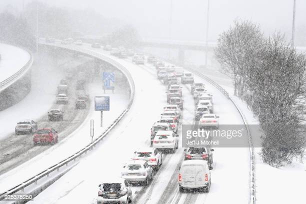 Vehicles drive through snow on the M8 in Glasgow on February 28 in Glasgow Scotland Freezing weather conditions dubbed the 'Beast from the East'...