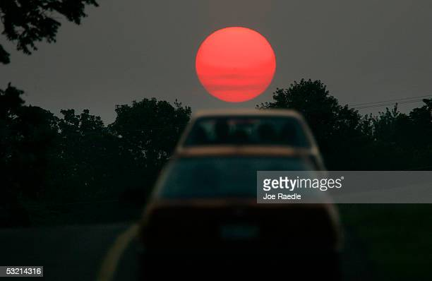 Vehicles drive through the Antietam battlefield July 4 2005 where General Robert E Lee ended his first invasion of the North in September 1862 in...