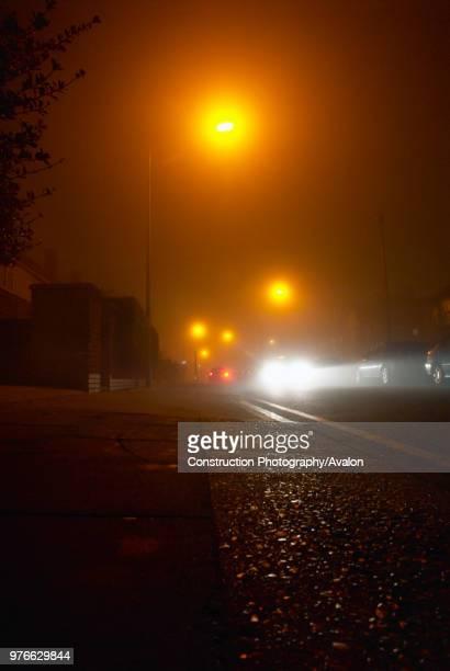 Vehicles driven on an urban street at night Ipswich UK