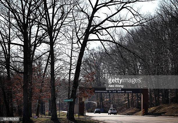 Vehicles enter Marine Corps Base Quantico March 22 2013 in Quantico Virginia A yet unidentified activeduty Marine shot and killed two of his comrades...