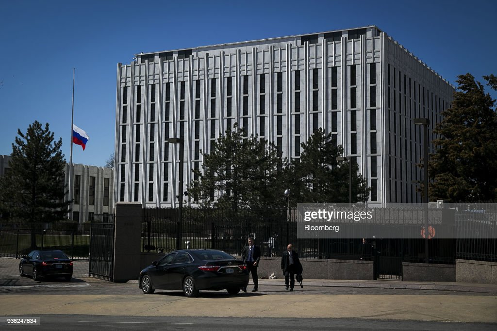 Vehicles enter the Russian Embassy in Washington, D C , U S
