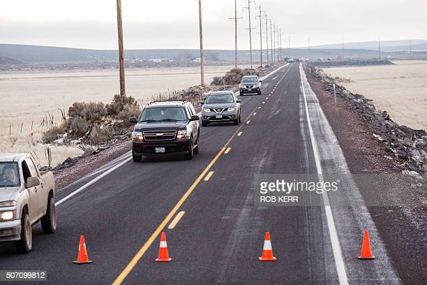 Vehicles exit a closed Highway 78 located approximately 4 miles from the Malheur Wildlife Refuge Headquarters near Burns Oregon on January 27 2016...