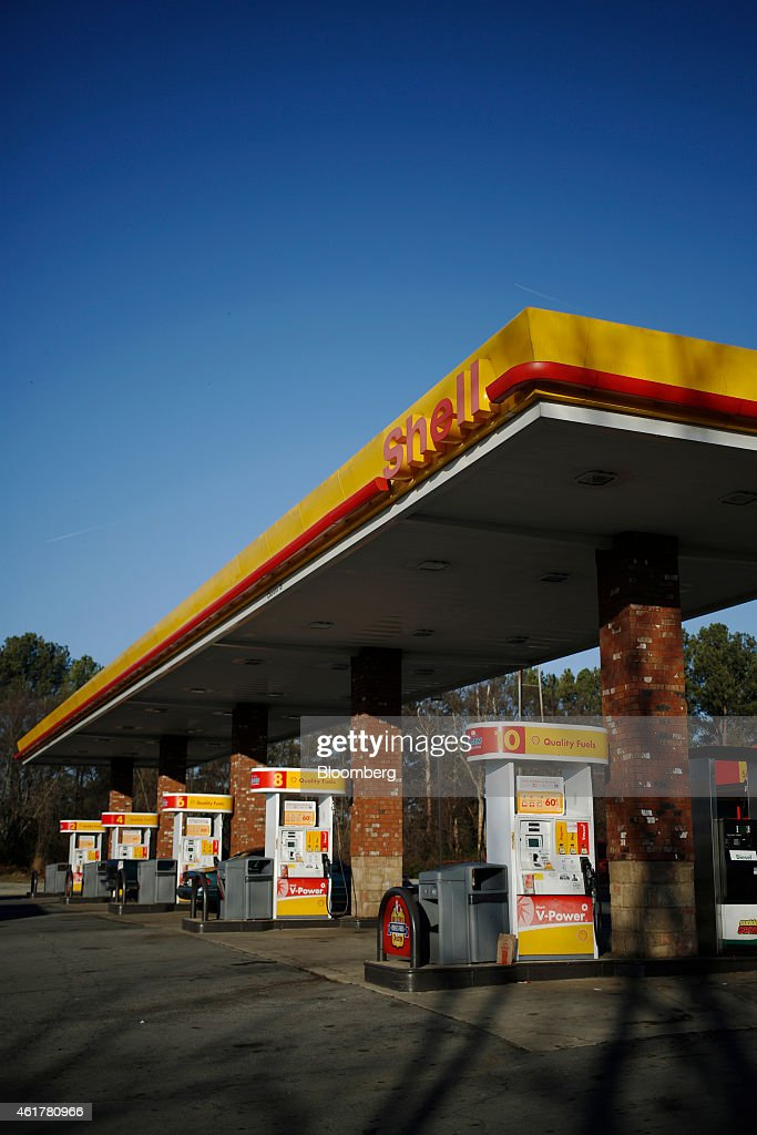 Vehicles fill up at a Royal Dutch Shell Plc gas station in