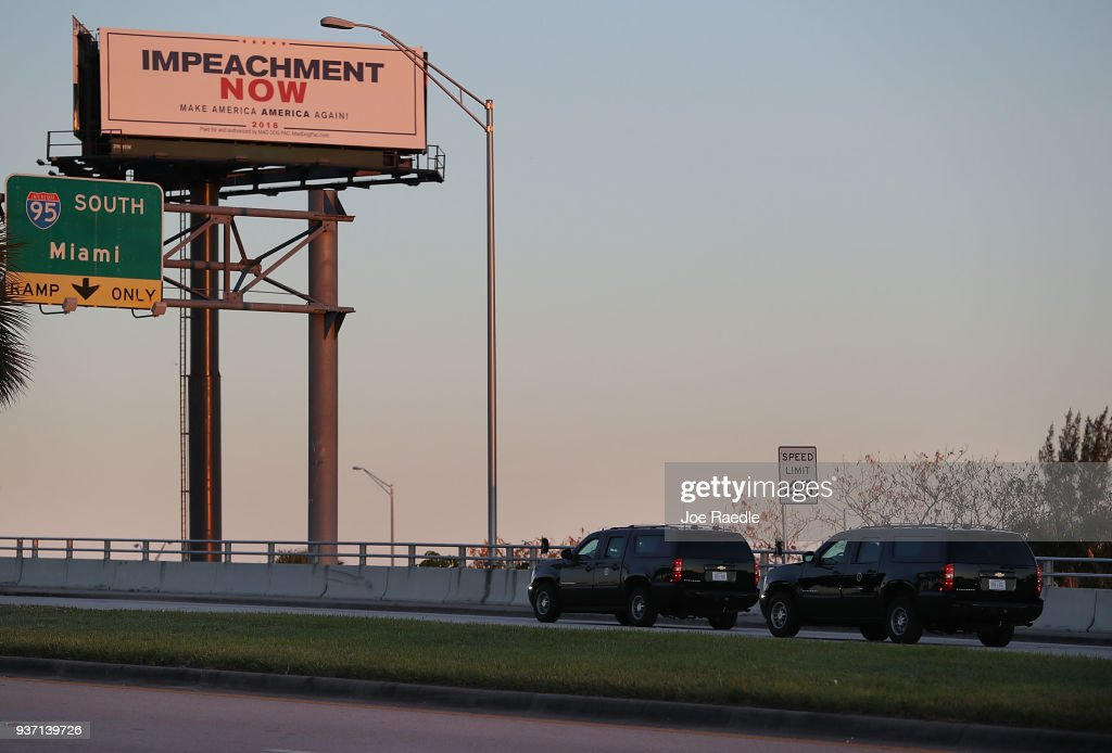 Trump's Motorcade Drives Past Impeachment Billboard En Route To Mar-A-Lago