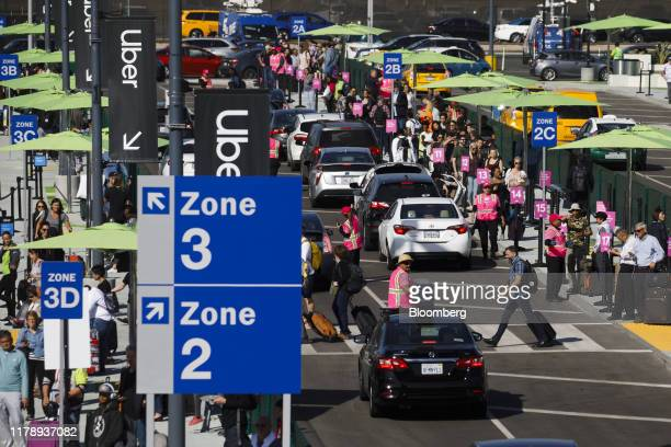 Vehicles from Uber Technologies Inc Lyft Inc and taxi cabs enter the LAXit centralized pickup area at Los Angeles International Airport in Los...