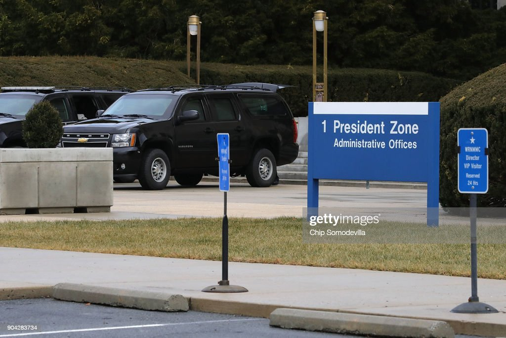 Vehicles from U.S. President Donald Trump's motorcade park outside Walter Reed National Military Medical Center as he undergoes his annual physical examination January 12, 2018 in Bethesda, Maryland. Trump will next travel to Florida to spend the Dr. Martin Luther King Jr. Day holiday weekend at his Mar-a-Lago resort.