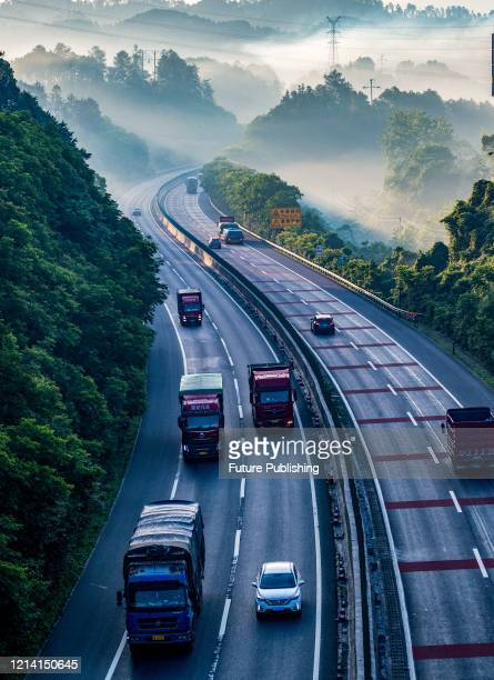 Vehicles full of goods are driving in Chongqing Jieshi Shuijiang section of G65 expressway. Chongqing, China, May 19, 2020. After the provincial toll...