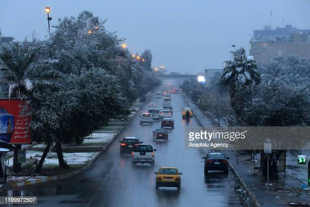 Vehicles go on a road during snowfall in Baghdad, Iraq on February 11, 2020.