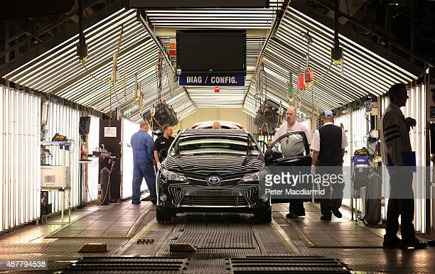 Vehicles go through final checks after being assembled on the production line at a Toyota plant on October 24 2014 in Derby England