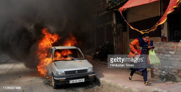 Vehicles go up in flames after scores of them were set ablaze by an angry mob during a protest against the killing of CRPF personnel in the Pulwama...