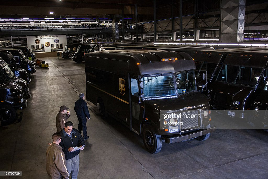 Vehicles head out for morning deliveries at the United Parcel Service (UPS) distribution center in Sacramento, California, U.S., on Thursday, Feb. 14, 2013. 100 UPS delivery all-electric vehicles, developed by Electric Vehicles International (EVI), have been deployed this week and are said to eliminate the use of 126,000 gallons of fuel per year. Photographer: Ken James/Bloomberg via Getty Images