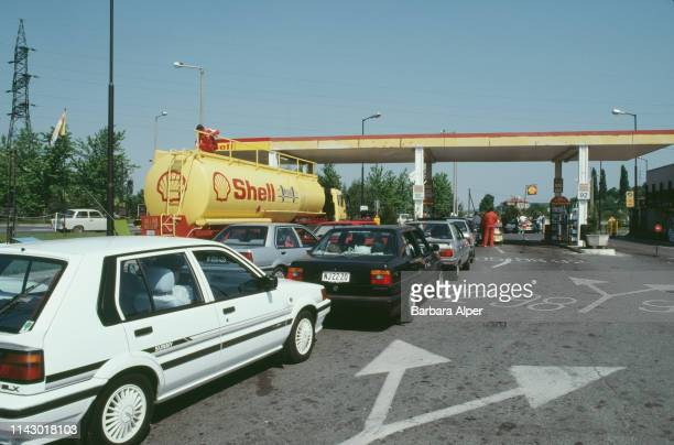 Vehicles in line at a Shell gas station in Sopron, Hungary, June 1990.