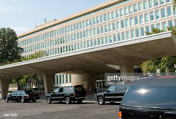 Vehicles in US President George W Bush's motorcade waits outside CIA Headquarters in Langley Virginia on August 14 as Bush meets with CIA Director...