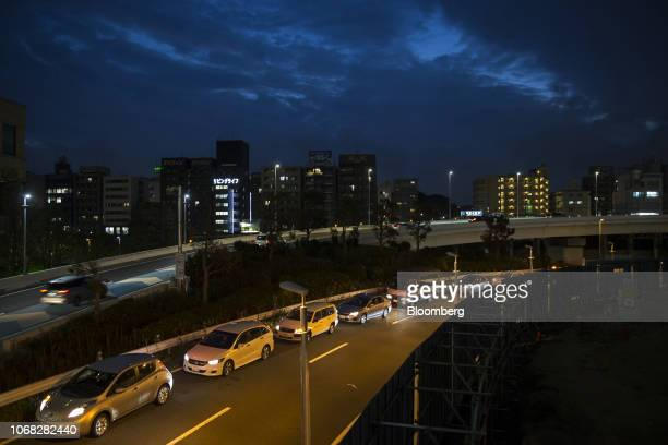 Vehicles including a Nissan Motor Co Leaf electric vehicle left are seen on a road at night in Yokohama Japan on Monday Dec 3 2018 Nissan's...