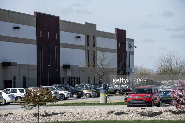 Vehicles, investigators, and police caution tape can be seen in the parking lot of a FedEx SmartPost on April 16, 2021 in Indianapolis, Indiana. The...