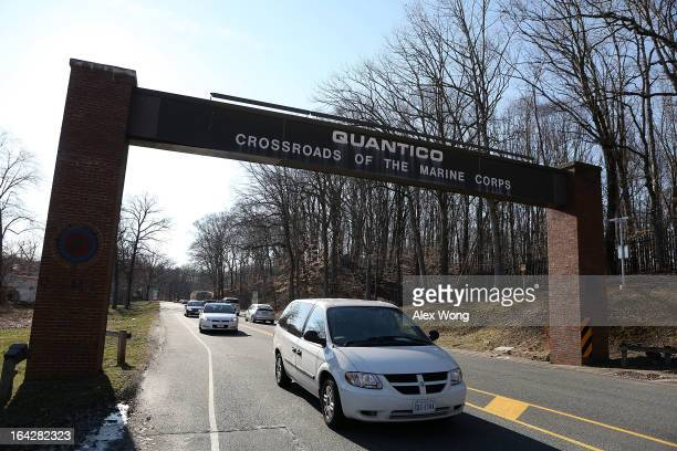 Vehicles leave Marine Corps Base Quantico March 22 2013 in Quantico Virginia A yet unidentified activeduty Marine shot and killed two of his comrades...