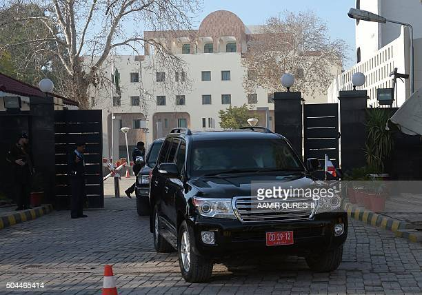Vehicles leave Pakistan's Foreign Ministry building a venue of the first ever round of fourway peace talks in Islamabad on January 11 2016 Pakistan's...