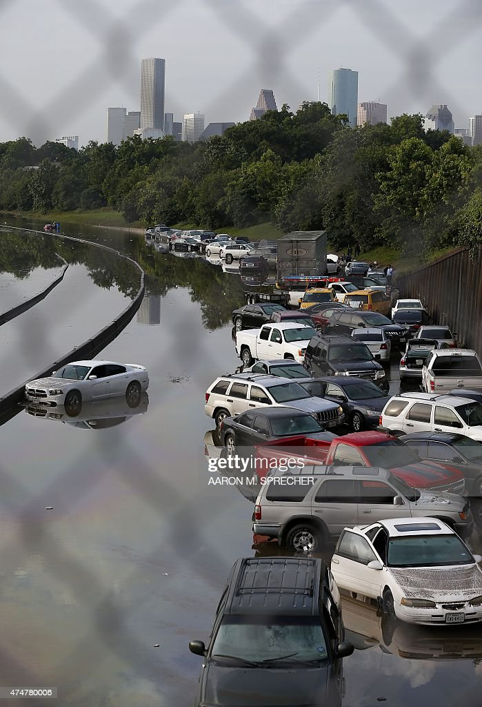 Vehicles left stranded on a flooded Interstate 45 in Houston, Texas on May 26, 2015. Heavy rains throught Texas put the city of Houston under massive ammounts of water, closing roadways and trapping residents in their cars and buildings, according to local reports. Rainfall reached up to 11 inches(27.9cm) in some parts of the state, national forecasters reported, and the heavy rains quickly pooled over the state's already saturated soil.