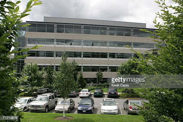 Vehicles lie in a parking lot area near a corporate building on the Microsoft Redmond Campus June 15 2006 in Redmond Washington Microsoft Chairman...