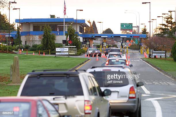 Vehicles line up to enter the United States at the border crossing between Blaine Washington and White Rock British Columbia November 8 2001 in White...