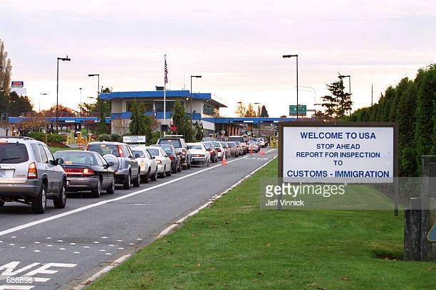 Vehicles line up to enter the United States at the border crossing between Blaine, Washington and White Rock, British Columbia November 8, 2001 in...