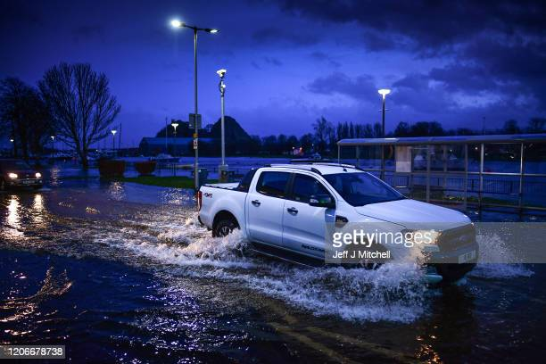 Vehicles make their way through flooding at Dumbarton Quay during storm Dennis on February 15 2020 in Dumbarton Scotland Towns in the Scottish...