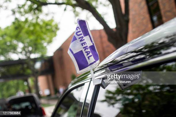 Vehicles marked for a funeral procession wait outside a memorial service for George Floyd at North Central University on June 4 2020 in Minneapolis...