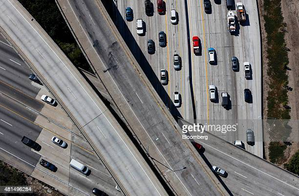 Vehicles move along the Interstate 405 freeway during rush hour in this aerial photograph taken over the Westwood neighborhood of Los Angeles...