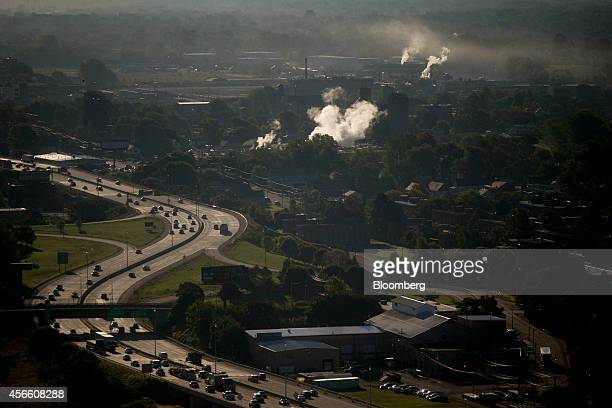 Vehicles move on the Niagara Thruway in Buffalo, New York, U.S., on Wednesday, Sept. 24, 2014. The Federal Reserve Bank of New York's empire state...
